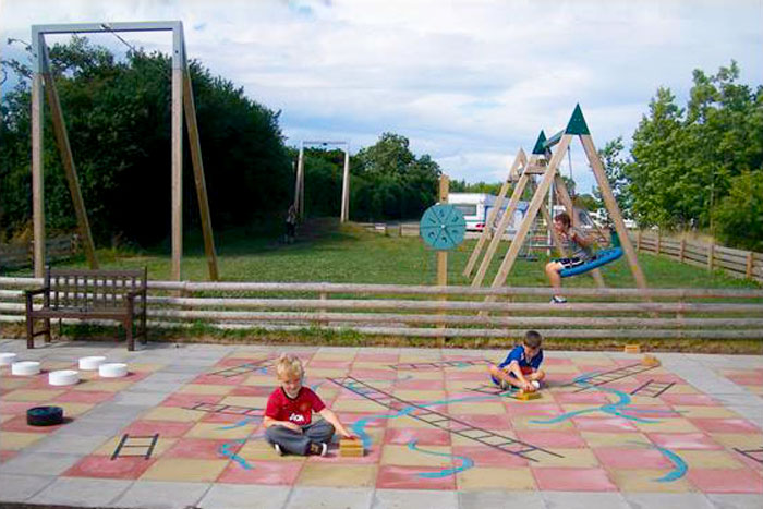Giant outdoor snakes and ladders board at York Meadows