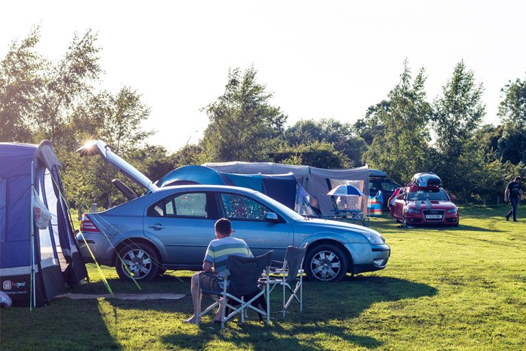 cars and tents at York Meadows