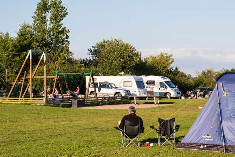 families enjoying the playground and relaxation at York Meadows Camping and Caravan Park