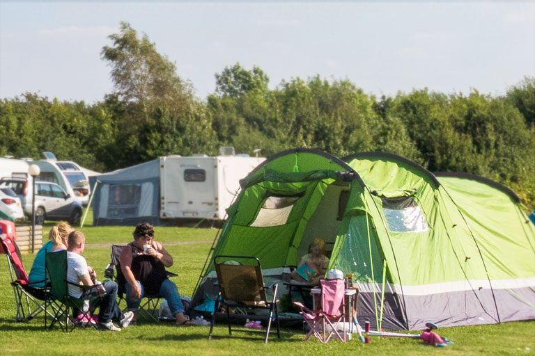family relaxing at York Meadows Camping and Caravan Park near York