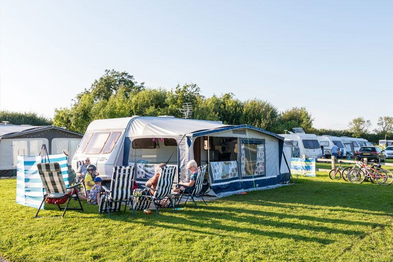 family enjoying a relaxing stay at York Meadows touring caravan park