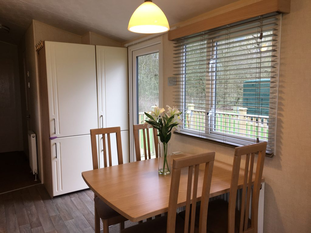 dining table inside a 2012 Willerby Sierra holiday home